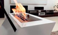 La cheminée éthanol Klino de marque Caleido – «X» dessiné par la flamme